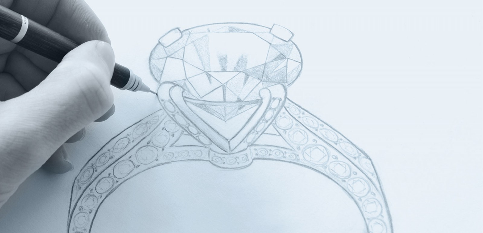 Link to The Process. Custom jewellery designer Julian Bartrom hand drawing a custom engagement ring design