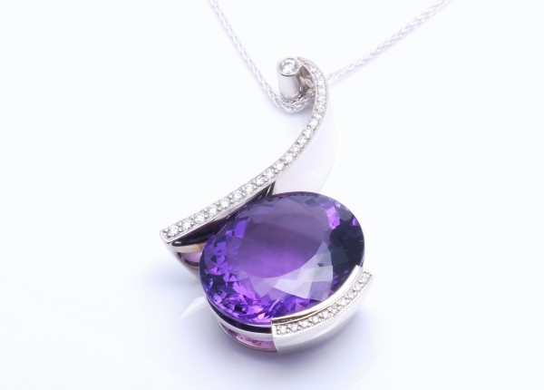 Designer pendant set with large oval Amethyst and grain set diamonds. Designer jewellery