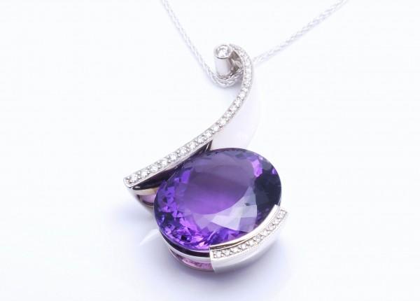 Designer pendant set with large oval Amethyst and grain set diamonds. Designer jewellery