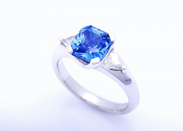Radiant cut blue Ceylonese sapphire with trillion cut diamonds set in platinum. Custom design and hand made item of fine jewellery
