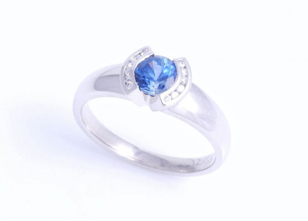 Custom designed blue sapphire engagement ring in contemporary design. Hand made in platinum.