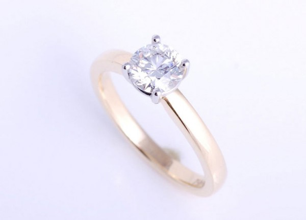 Sparkling diamond ring. Set with a 0.75ct brilliant cut diamond and hand made to order in 18ct yellow gold and platinum