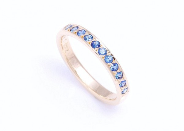 Ceylonese blue sapphire wedding ring set in 18ct yellow gold. Custom made wedding ring to match engagement ring.