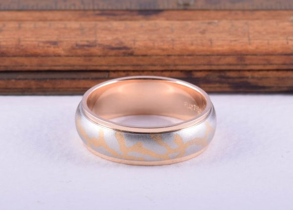 Men's Lord of the Ring style wedding ring in platinum and rose by Auckland jewellery designer Julian Bartrom Jewellery.