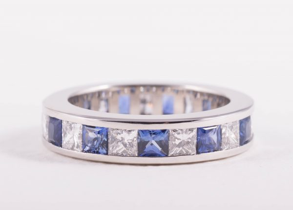 Alternating princess cut Ceylonese sapphire and diamonds ring in platinum by bespoke jewellery designer Julian Bartrom Jewellery.