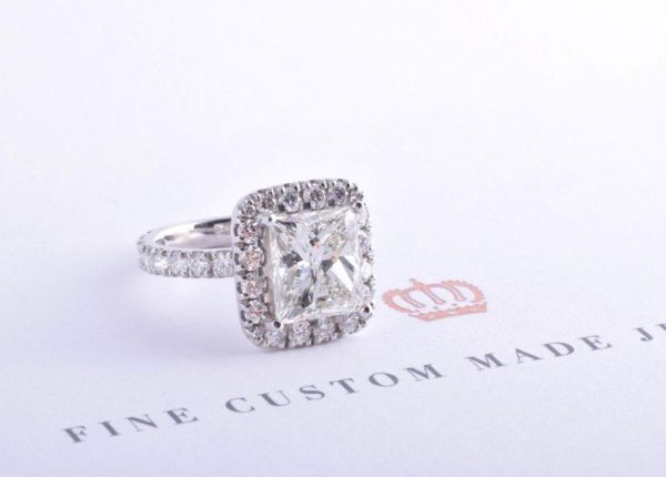 Princess cut diamond halo engagement ring by Auckland diamond expert Julian Bartrom from Julian Bartrom Jewellery.