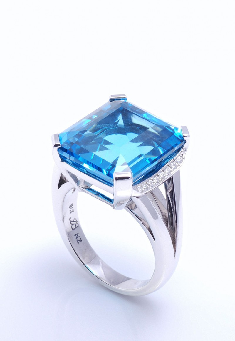 Auckland jewellery designers. Blue topaz, custom design dress ring set in 9 ct white gold with diamonds