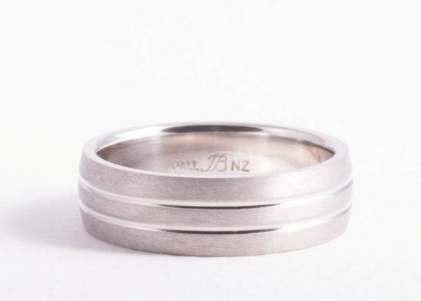 Men's palladium wedding band with a brushed finish designed and made by bespoke jewellery designer Julian Bartrom Jewellery.