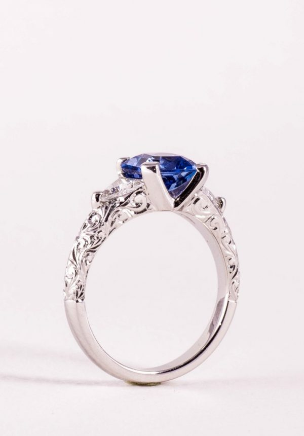 Ceylonese sapphire and diamond engagement ring with hand engraving by bespoke jewellery designer Julian Bartrom Jewellery
