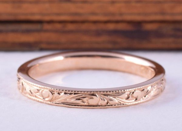 Ladies wedding ring hand engraving in 18ct rose gold by jewellery designer Julian Bartrom Jewellery